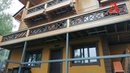 Дом из бруса и штукатурный фасад с искусственным камнем